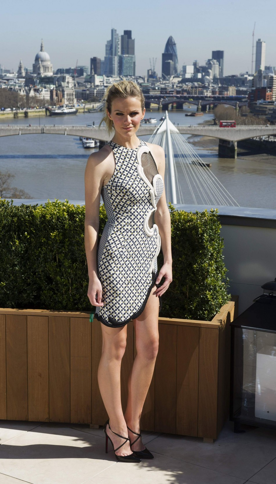 Actress Brooklyn Decker poses for a photograph at a media viewing to promote the film Battleship, at a hotel in central London