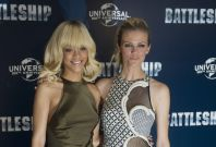Singer Rihanna and model Brooklyn Decker pose for a photograph at a photocall to promote the film 'Battleship', in a hotel in central London