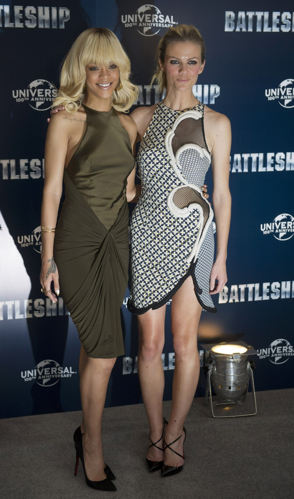 Singer Rihanna and model Brooklyn Decker pose for a photograph at a photocall to promote the film Battleship, in a hotel in central London