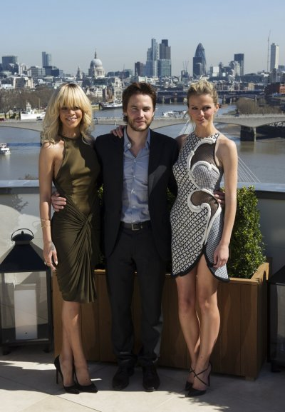 Singer Rihanna poses with Taylor Kitsch and Brooklyn Decker for a photograph during a media viewing to promote the film Battleship, at a hotel in central London