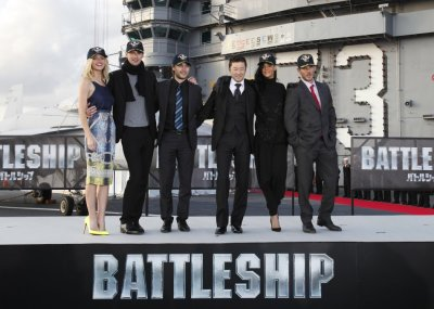 Cast members of the film quotBattleshipquot pose during a news conference atop a flight deck of aircraft carrier USS George Washington at Yokosuka port, south of Tokyo