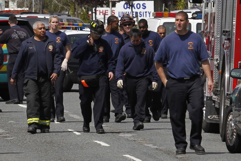 Fire fighters leave the site of a multiple shooting at a private Christian college in Oakland
