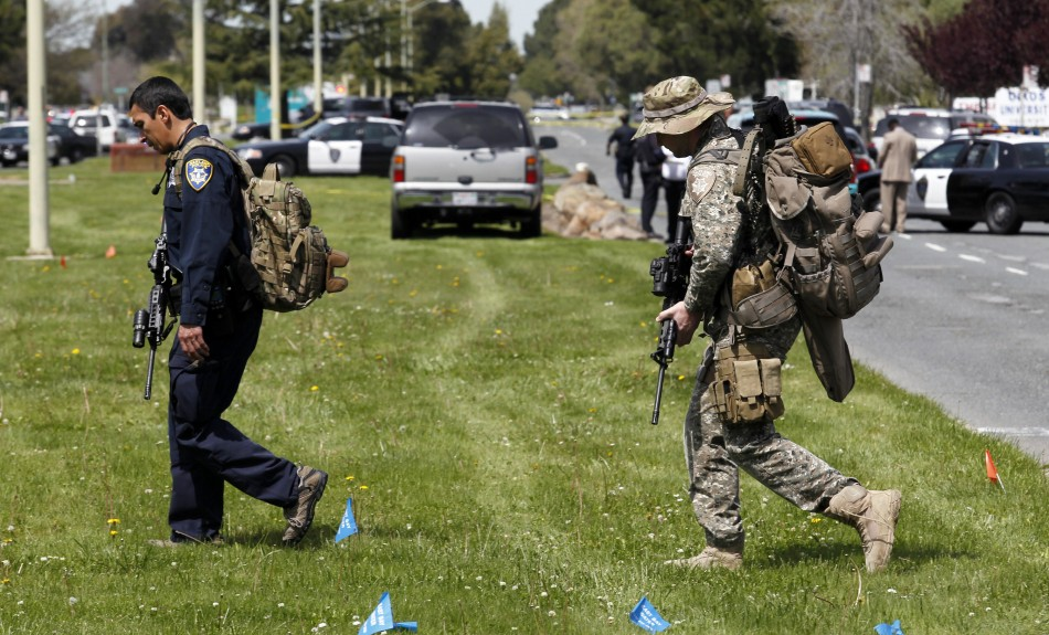 Officers leave the scene of a multiple shooting at a private Christian college in Oakland