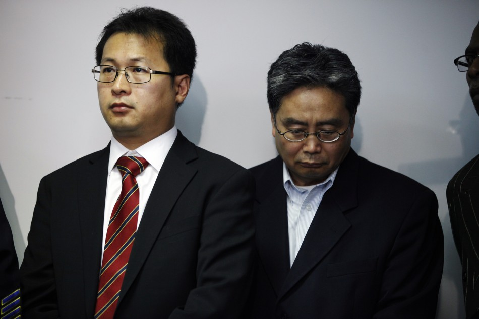 Hyok-in Kwon and Kyung Kim of the Korean United Methodist Church attend a news conference at the Oakland Police Headquarters after a shooting incident at Oikos University in Oakland