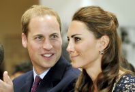 Britain's Prince William looks at his wife, Catherine, the Duchess of Cambridge, during their visit to the Inner City Arts club in Los Angeles