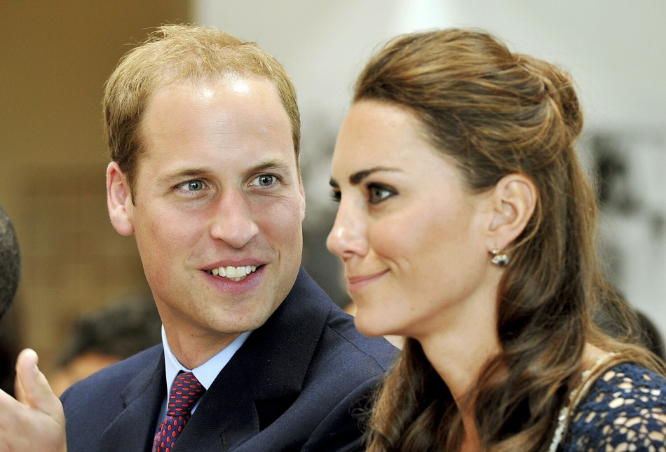 Britains Prince William looks at his wife, Catherine, the Duchess of Cambridge, during their visit to the Inner City Arts club in Los Angeles