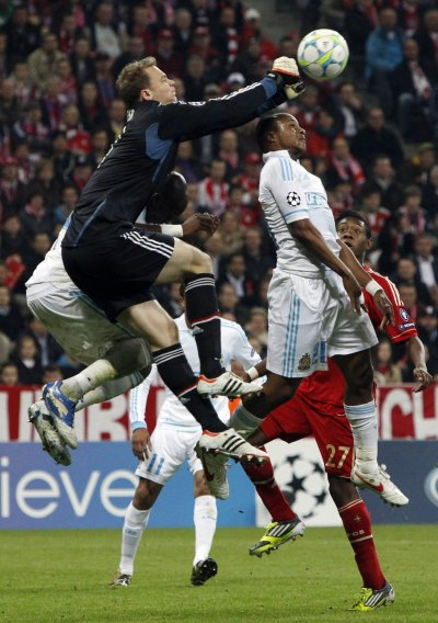 Bayern Munich039s goalkeeper Neuer saves ball against Olympique Marseille039s Ayew during Champions League quarter-final soccer match in Munich