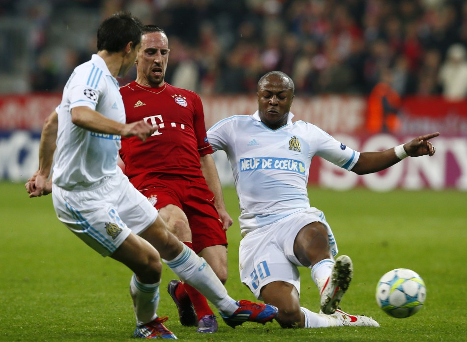 Franck Ribery , French midfielder of Bayern Munich outplays Azpilicueta and Andre Ayew of Olympique Marseille during their Champions League quarter-final second leg soccer match in Munich