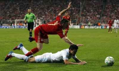 Bayern Munich039s Ribery falls over Olympique Marseille039s Azpilicueta during Champions League quarter-final soccer match in Munich