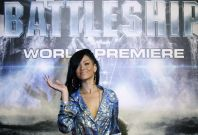 "Singer and cast member Rihanna poses on the red carpet as she arrives for the world premiere of the film ""Battleship"" in Tokyo"