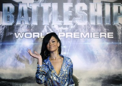 Singer and cast member Rihanna poses on the red carpet as she arrives for the world premiere of the film quotBattleshipquot in Tokyo