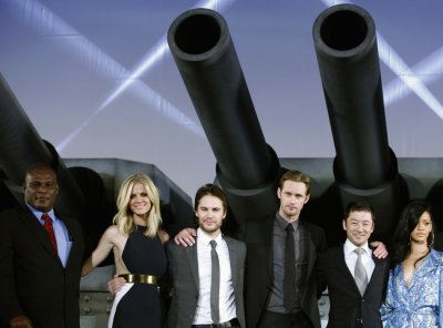 Cast members of the film quotBattleshipquot pose at the world premiere event for the film in Tokyo