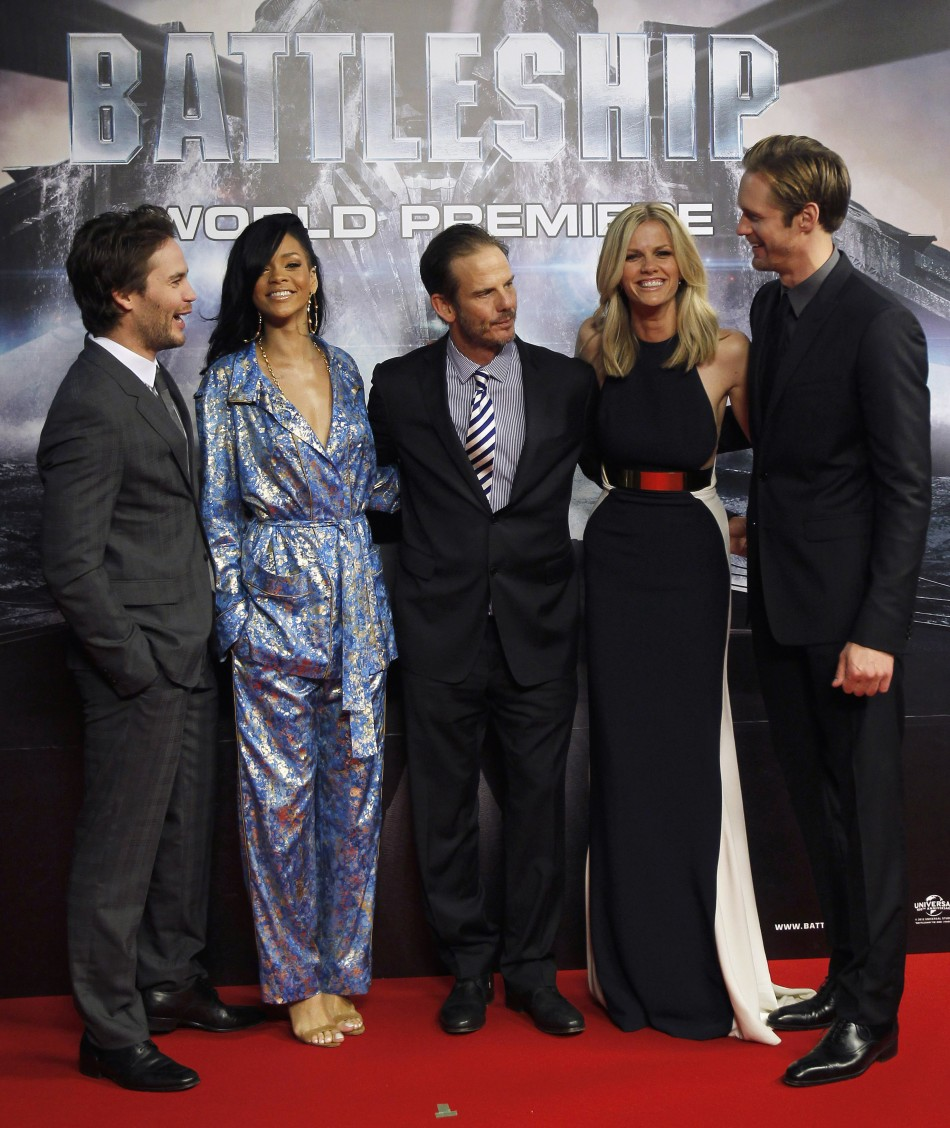 Director Berg poses with his cast members of his film quotBattleshipquot on the red carpet in Tokyo