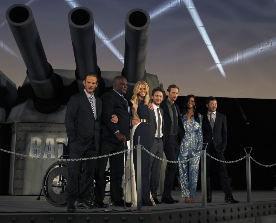 Director Berg poses with cast members of his film quotBattleshipquot at the films world premiere in Tokyo