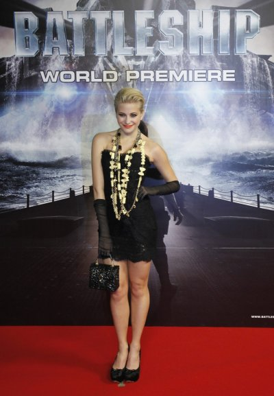 British singer Lott poses on the red carpet as she arrives for the world premiere of the film quotBattleshipquot in Tokyo