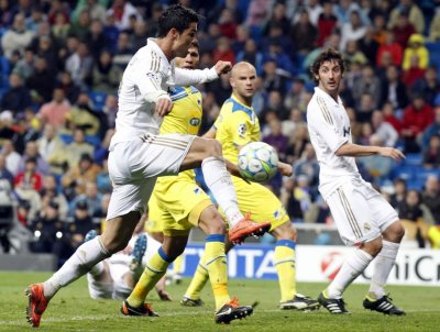Real Madrid039s Ronaldo shoots to score against APOEL during their Champions League quarter-final second leg soccer match in Madrid