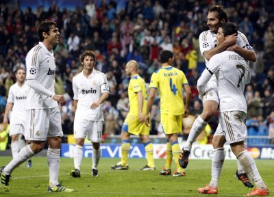 Real Madrid039s Ronaldo celebrates with Altontop after scoring a goal against APOEL during their Champions League quarter-final second leg soccer match in Madrid
