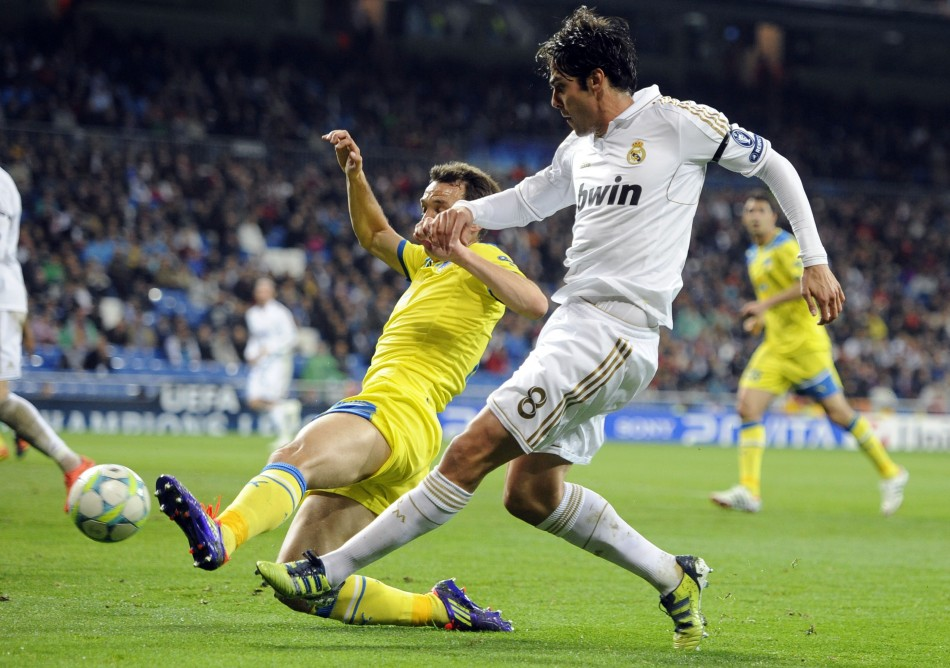 Real Madrid039s Kaka and APOEL039s Manduca challenge for the ball during their Champions League quarter-final second leg soccer match in Madrid