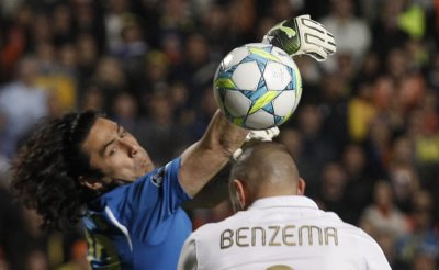 APOEL039s goalkeeper Chiotis saves the ball from a header of Real Madrid039s Benzema during their Champions League quarter-final first leg soccer match in Nicosia
