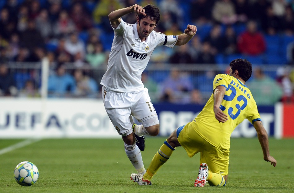 Real Madrid039s Granero and APOEL039s Pinto challenge for the ball during their Champions League quarter-final second leg soccer match in Madrid
