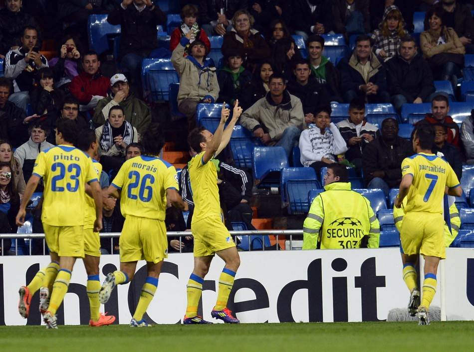 APOEL039s players celebrate a goal during their Champions League quarter-final second leg soccer match against Real Madrid in Madrid