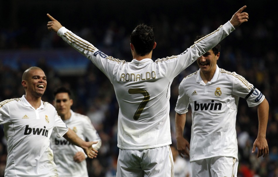 Real Madrid039s Ronaldo celebrates a goal with Pepe and Sahin after scoring against APOEL during their Champions League quarter-final second leg soccer match in Madrid