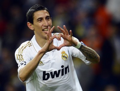 Real Madrid039s Angel Di Maria celebrates after scoring a goal during their Champions League quarter-final second leg soccer match gainst APOEL at Santiago Bernabeu stadium in Madrid