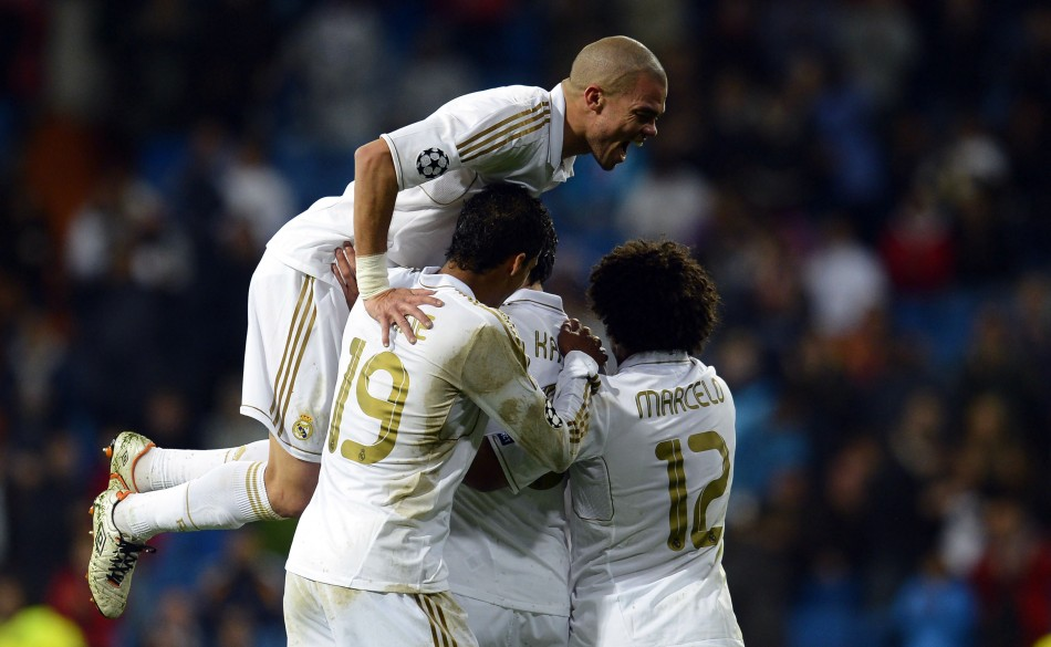 Real Madrid039s players celebrate a goal against APOEL during their Champions League quarter-final second leg soccer match at Santiago Bernabeu stadium in Madrid