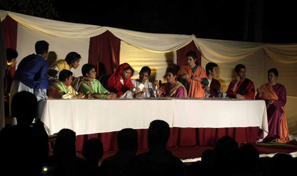 Actors take part in a quotVia Crucisquot re-enactment of the Last Supper during a Good Friday celebration in Luque