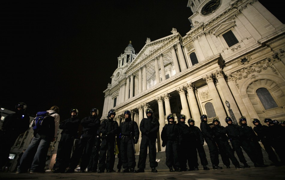 Police oversee Occupy London protest camp outside St Paul's
