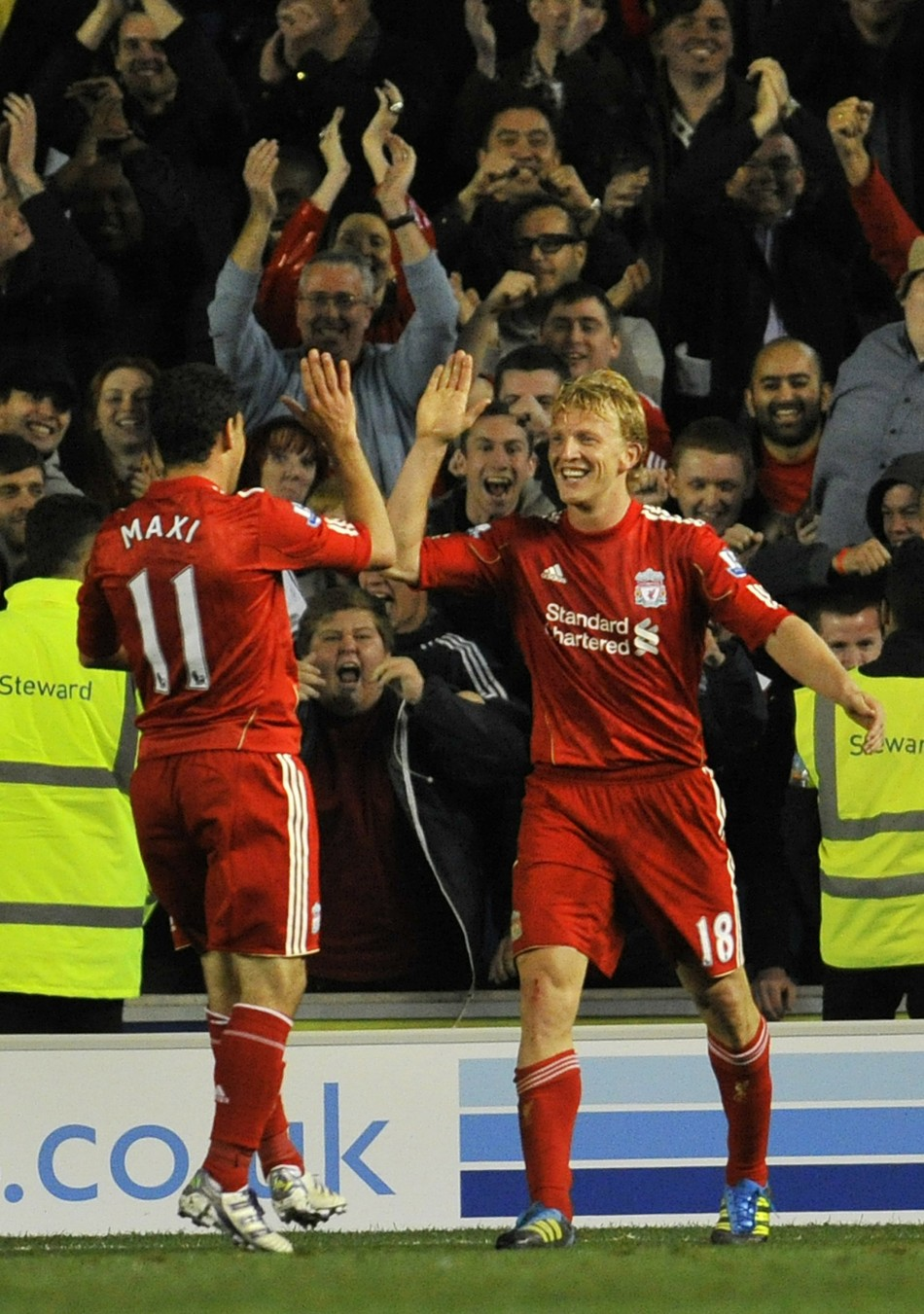 Liverpool's Dirk Kuyt and Maxi Rodriguez