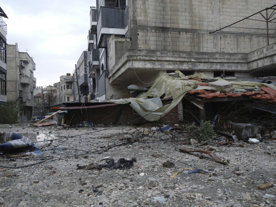Damaged buildings in the old city of Homs