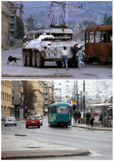 Three boys run behind a Ukrainian United Nations UN armoured personnel carrier APC as it moves past a burnt-out tram in Skenderia square in the besieged Bosnian capital of Sarajevo, in this file picture taken August 10, 1993, and vehicles, including a