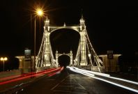 Cars drive over Albert Bridge in London