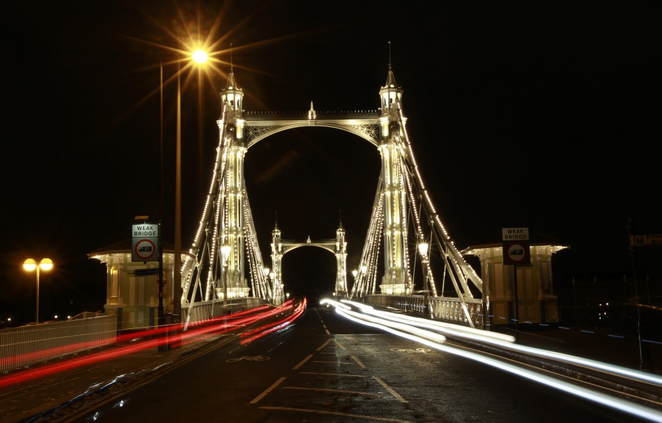 Cars drive over Albert Bridge in London