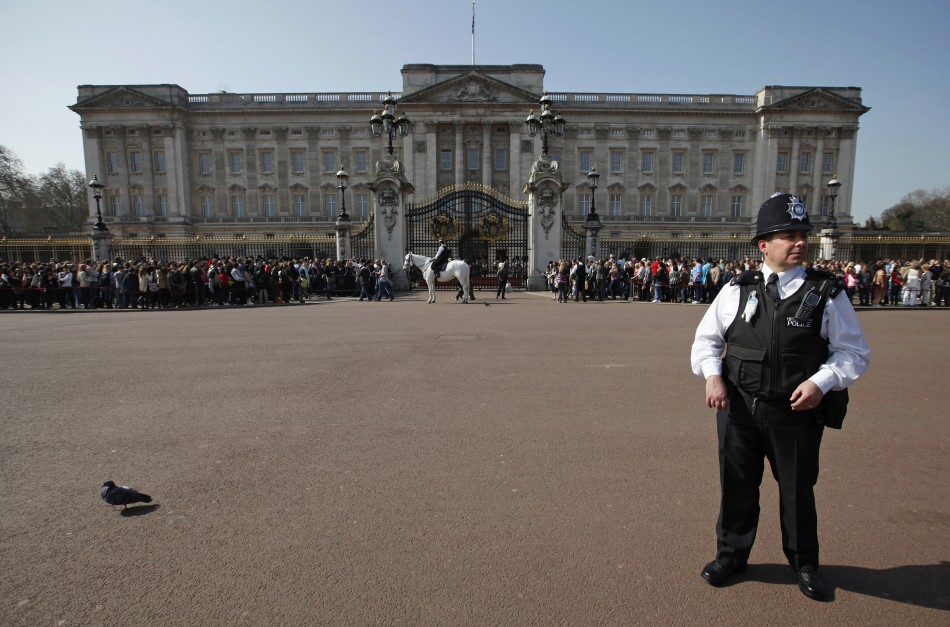 A police officer watches the crowd in front of Buckingham Palace