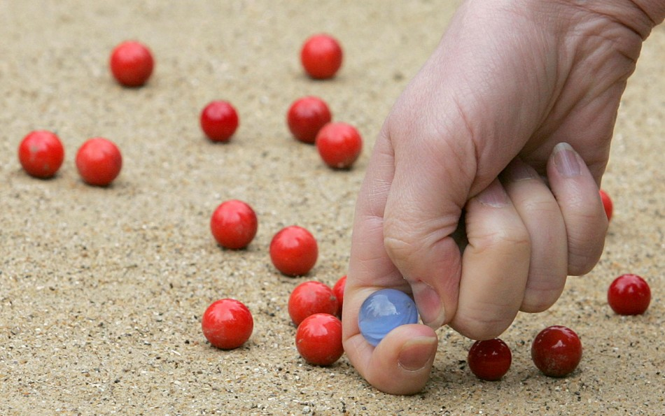 A participant competes at the World Marbles Championships near Crawley in West Sussex