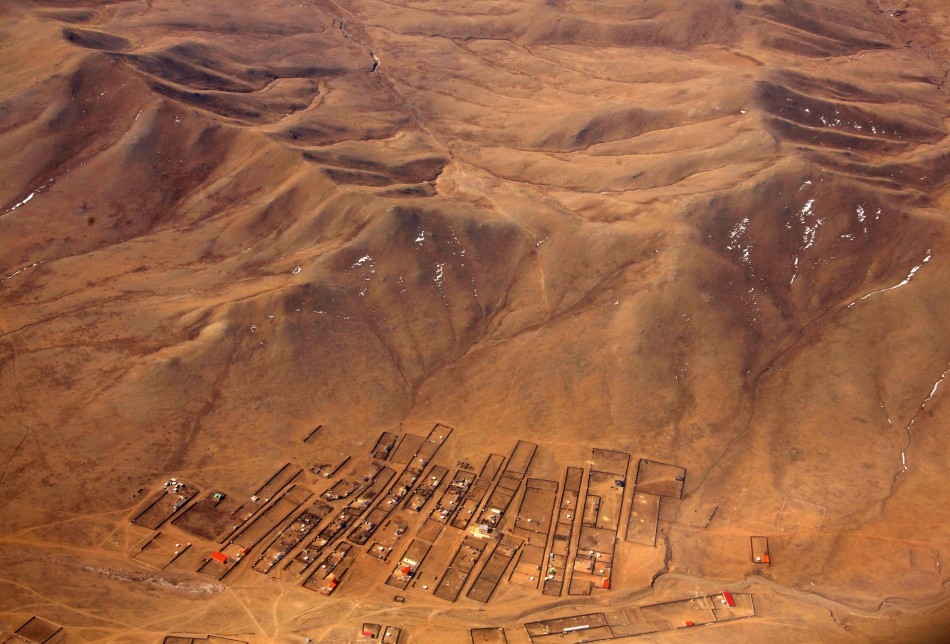 A village is seen at the base of hills located on the outskirts of the Mongolian capital city of Ulan Bator
