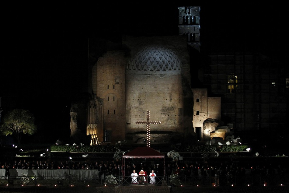Pope Benedict XVI leads the Via Crucis procession at the Colosseum in downtown Rome