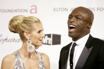 Singer Seal laughs with his wife, model Klum, as they arrive at the 16th Annual Elton John AIDS Foundation Party in West Hollywood