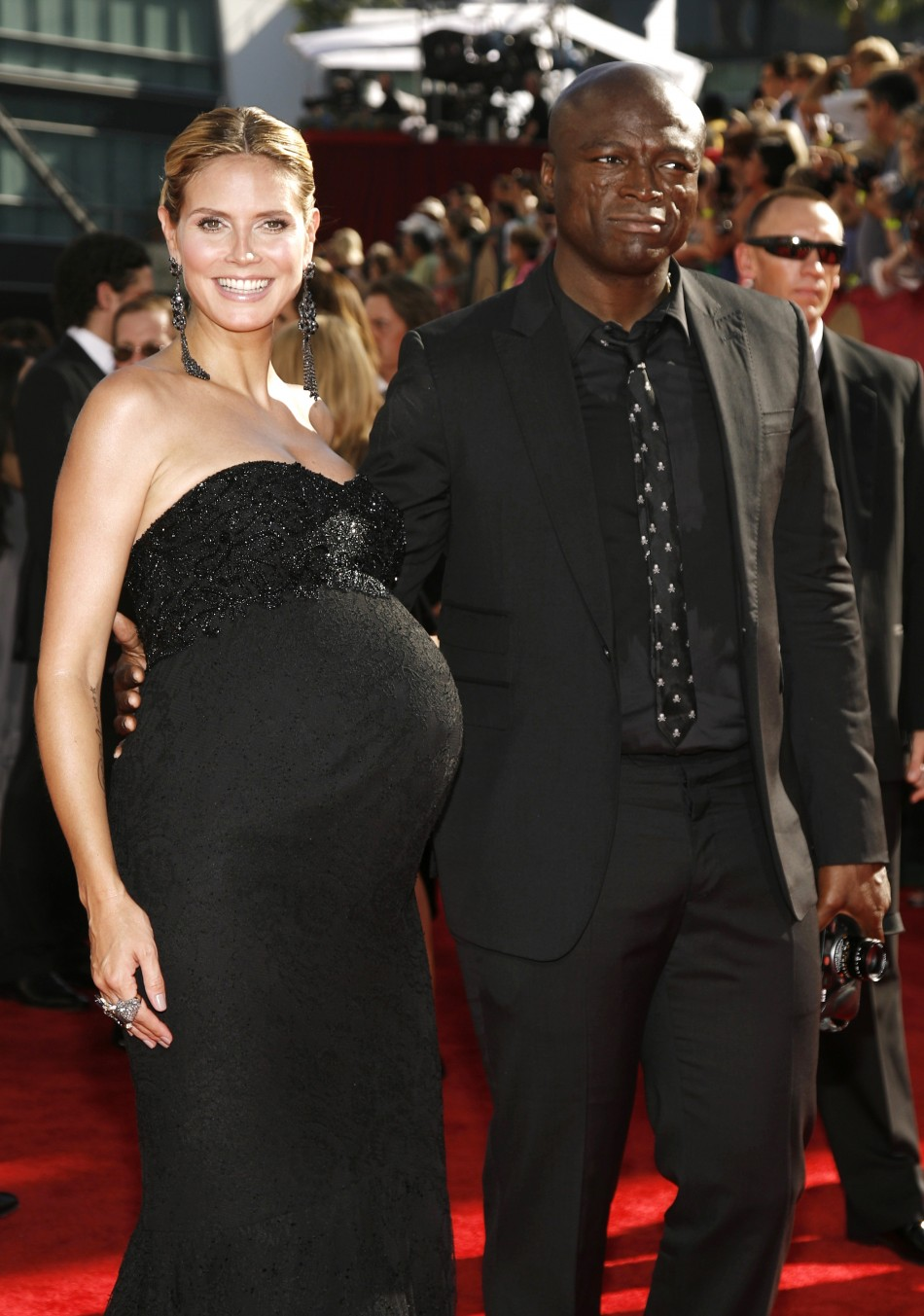 "Nominee Heidi Klum of ""Project Runway"" with husband singer Seal arrive on the red carpet at the 61st annual Primetime Emmy Awards in Los Angeles"