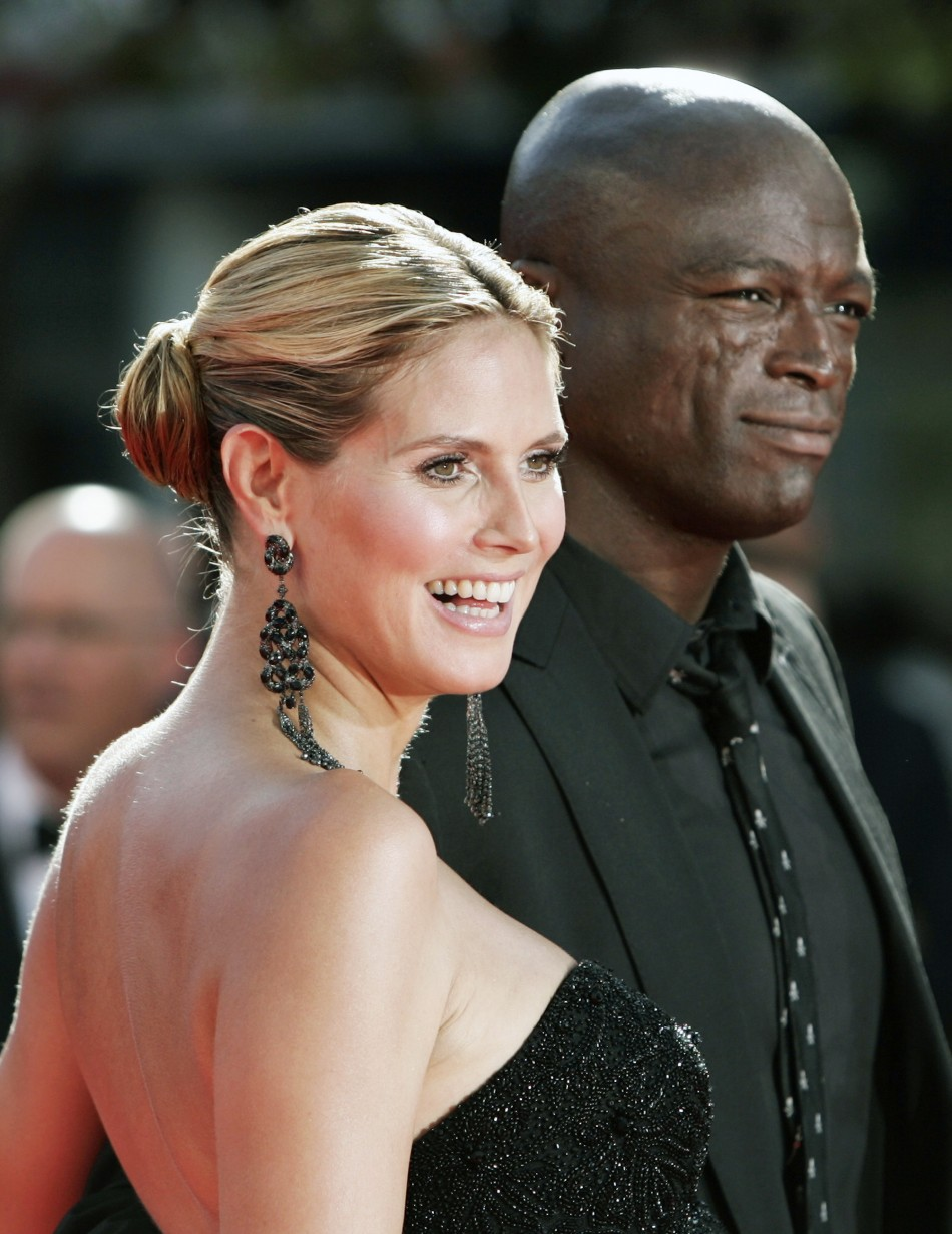 "Heidi Klum from ""Project Runway"" and musician Seal arrive at the 61st annual Primetime Emmy Awards in Los Angeles"