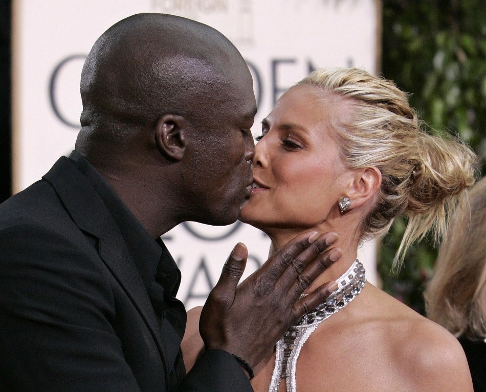 Supermodel Heidi Klum gets kiss from husband singer Seal at 63rd Annual Golden Globe Awards in Beverly Hills