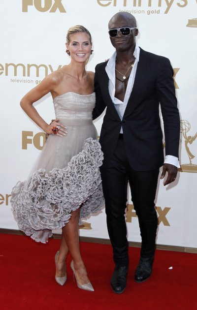 Television host Heidi Klum and her husband, singer Seal, arrive at the 63rd Primetime Emmy Awards in Los Angeles