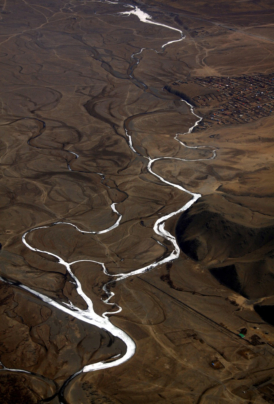 A frozen river is seen located on the outskirts of the Mongolian capital city of Ulan Bator