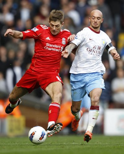 Aston Villa039s Ireland challenges Liverpool039s Gerrard during their English Premier League soccer match in Liverpool