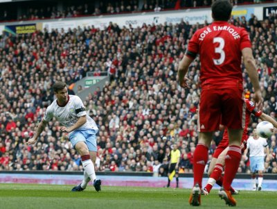 Aston Villa039s Herd scores against Liverpool during their English Premier League soccer match in Liverpool