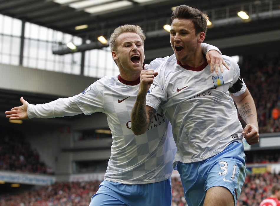 Aston Villa039s Herd celebrates his goal against Liverpool with Bannan during their English Premier League soccer match in Liverpool