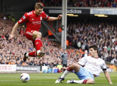 Aston Villa039s Lichaj challenges Liverpool039s Gerrard during their English Premier League soccer match in Liverpool