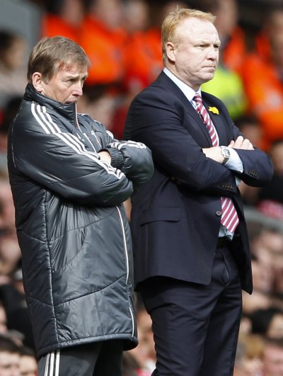 Liverpool039s manager Dalglish and his Aston Villa counterpart McLeish watch their teams during their English Premier League soccer match in Liverpool